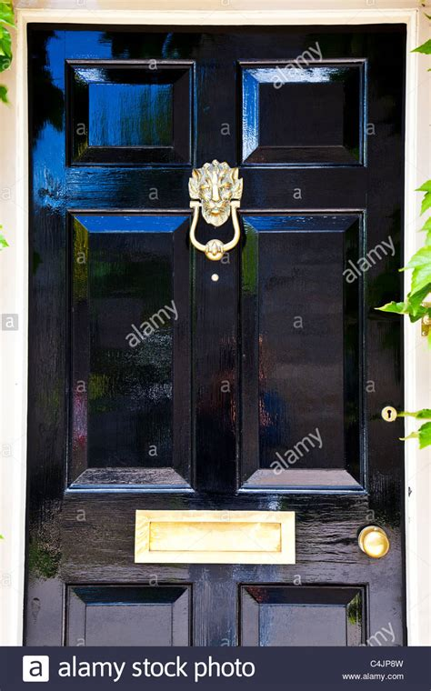 Black Front Door Furniture A Shiny High Gloss Black Painted Front Door With Highly Polished Stock Photo Royalty Free Image