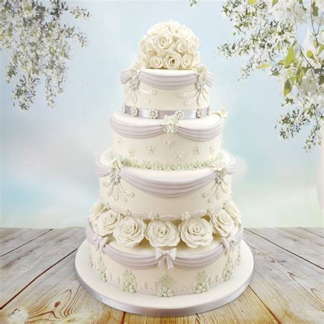 Tiered Wedding Cake Decorated With Swags Drapes And