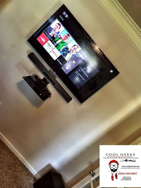 tv and soundbar mounted with floating shelf for xbox one