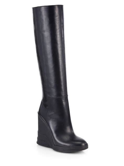 prada leather knee high wedge boots in black nero black