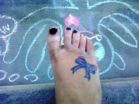 small bow tattoo on foot 40 decent bow tattoos on foot