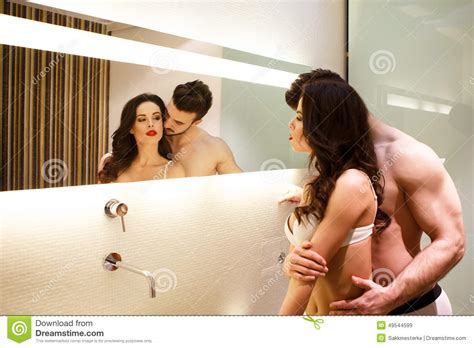 blowjob in a bathroom young couple posing in mirror stock photo image 49544599