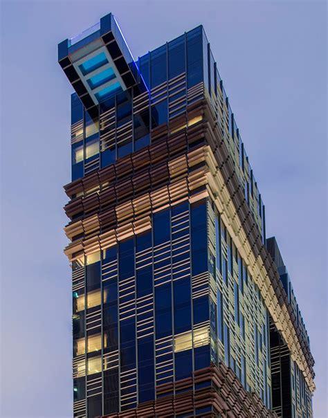 designboom resort glass pool cantilevers from hong kong s hotel indigo by aedas