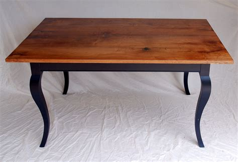 custom mesquite dining table with ebonized cabriole legs