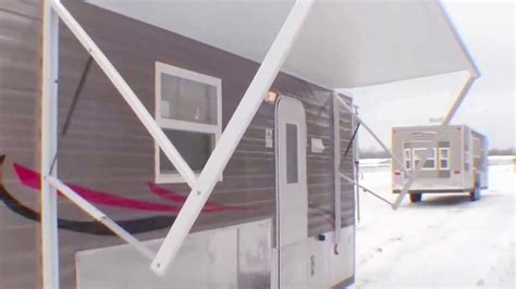 power awning for house 2014 ice castle 21 rv edition fish house cer with bronze exterior power awning