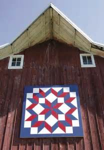 the quilt pattern on display on the barn of jean