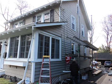 re siding a house cost front overhang require attention