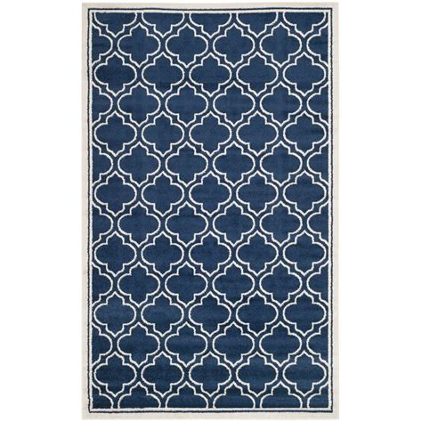 9 ft outdoor rug safavieh amherst navy ivory 6 ft x 9 ft indoor outdoor area rug amt412p 6 the home depot