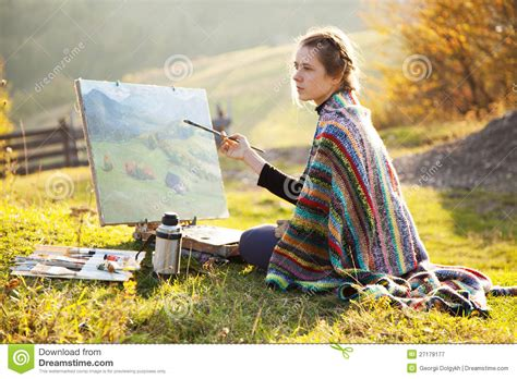 a painter young artist painting a landscape royalty free stock
