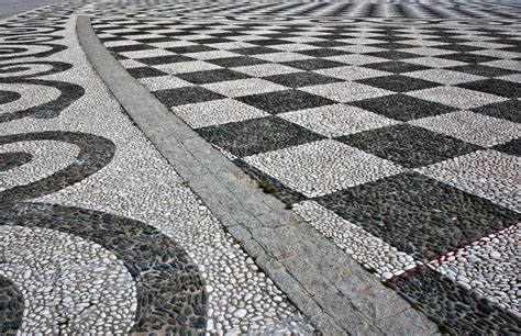 chequer pattern in spanish black and white checker floor tile pattern stock photo