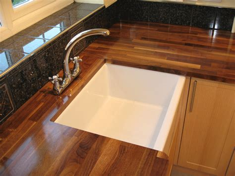 fitting a kitchen sink belfast sink set into american black walnut worktop