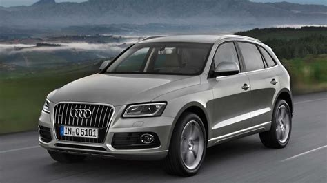 audi    hybrid review  specs  features