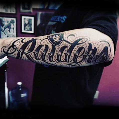 forearm script tattoos for men 40 oakland raiders tattoos for football ink design