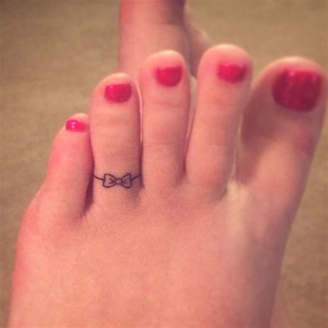 small bow tattoo on foot bow images designs