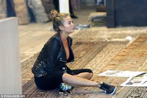 hailey best rug and home chrissy teigen showcases cleavage while shopping with legend daily mail
