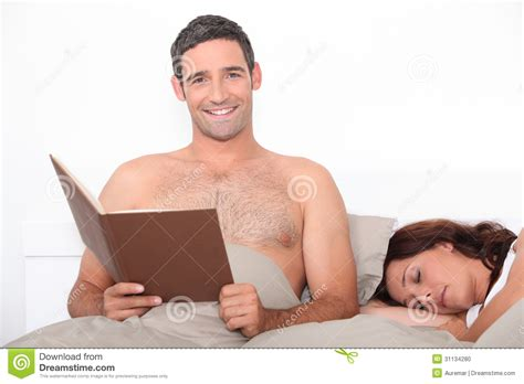 reading in bed man reading in bed stock photo image 31134280