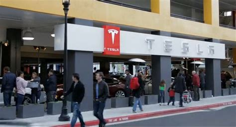 tesla ceo says company owned outlets are ev