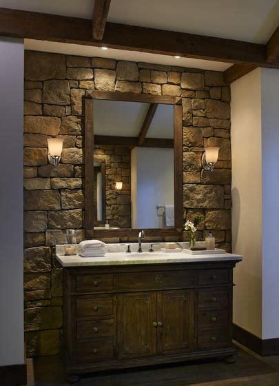 bathroom stone wall stone wall behind bathroom vanity dark wood cabinet