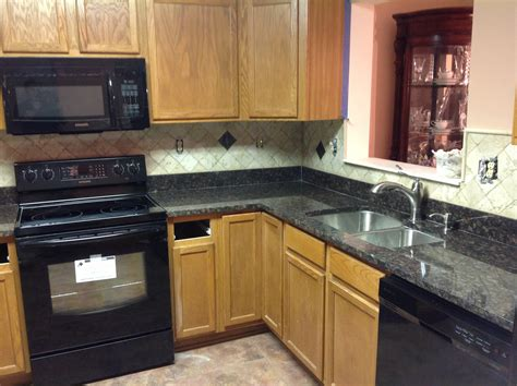 Kitchens With Backsplash Donna S Brown Granite Kitchen Countertop W Travertine Backsplash Granix
