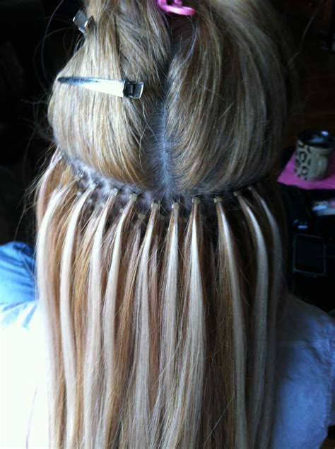 how to put micro bead extensions in 1000 ideas about micro bead hair extensions on