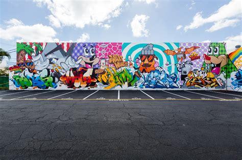 Banksy Wall Mural powwow hawaii lars