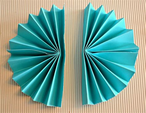 Make Paper Fan - how to make paper rosettes diy decorations the