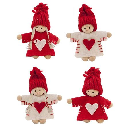 red and white mini christmas tree decoration by the