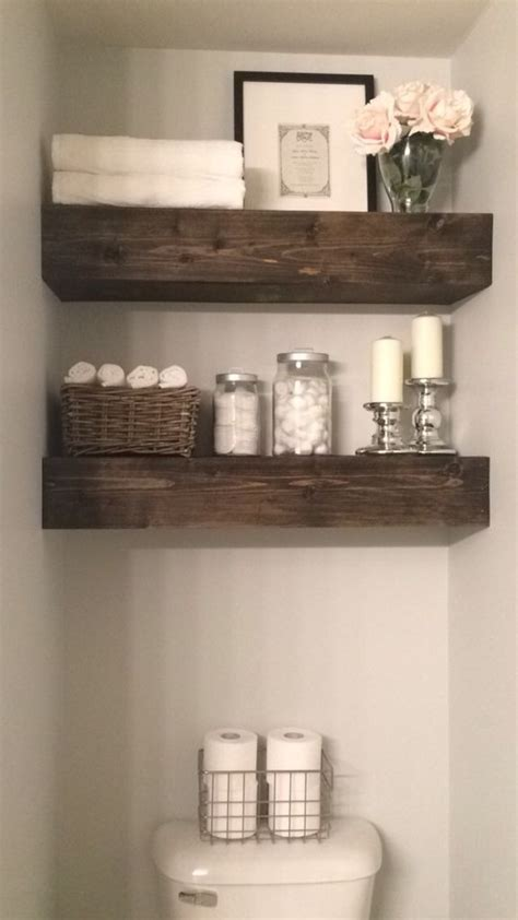 Floating Shelves Above The Toilet In This Bathroom Is Much Bathroom Shelves Above Toilet