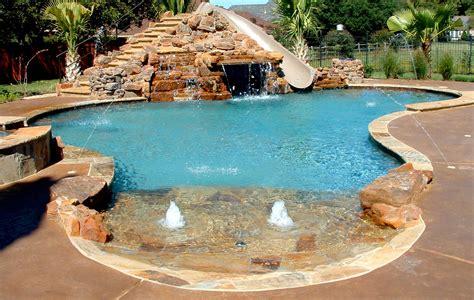 inground pools with rock slides swimming pool