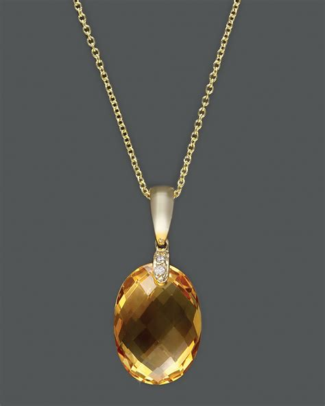 Citrine Ct 01 and citrine pendant in 14k yellow gold 16