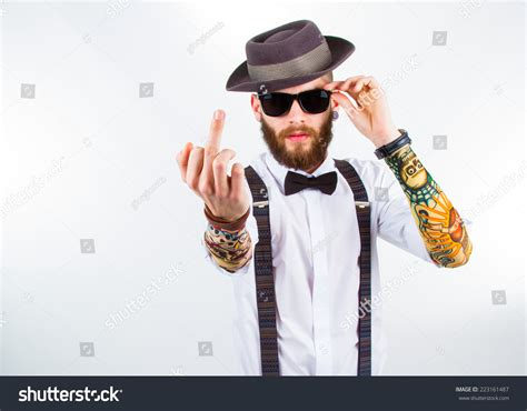 young hipster man wearing hat suspenders stock photo
