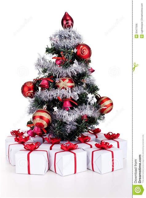 when christmas trees were small small tree with lots of presents stock photo image 35477556