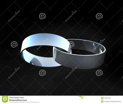 white gold or platinum wedding rings linked together stock