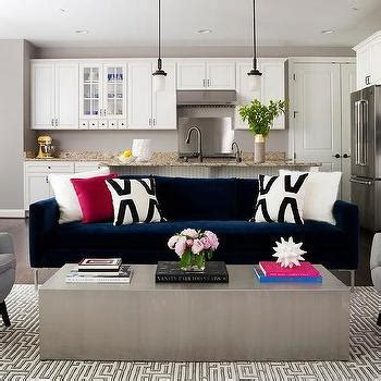 dark blue velvet sofa living rooms low metal and wood cocktail table design ideas