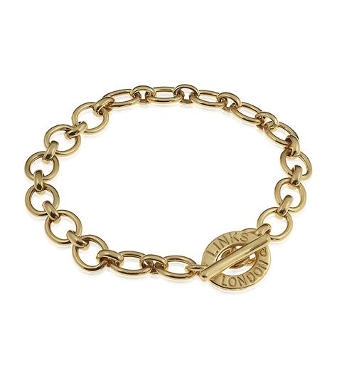 links of charm bracelet in gold lyst