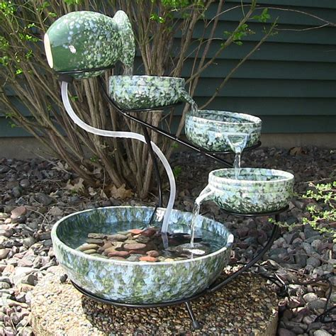 Decorative Outdoor Solar Water Fountains by Outdoor Classics Decorative Green Ceramic Cascade Solar