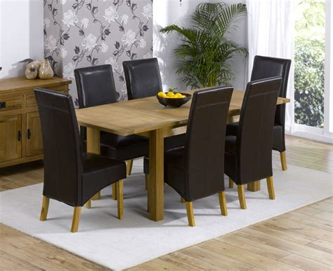 dining table and leather chairs cipriano extending oak dining table and 6 leather chairs