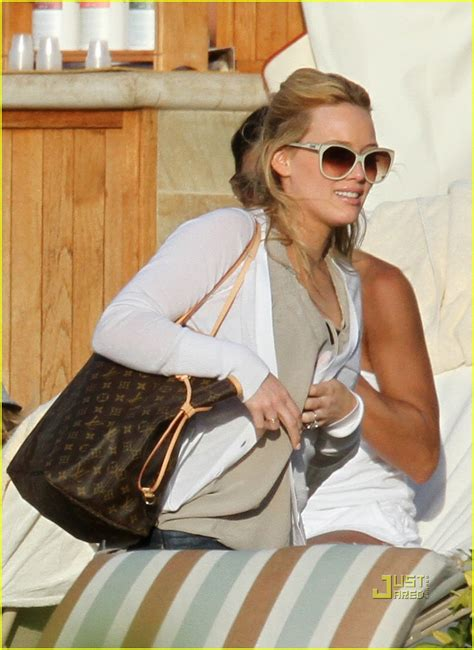 Other Designers Hilary Duff With Designer Travel Bags by Louis Vuitton Handbags Luxurious Taste For High Fashion