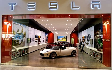 tesla dealership auto dealers whine that tesla stores are illegal wired