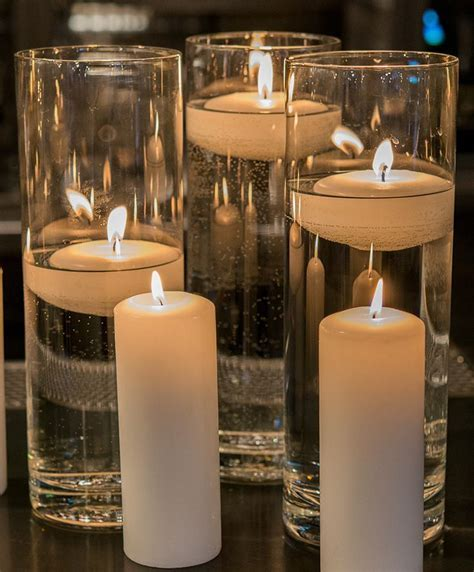 Pair pillar candles with glass vases at your wedding