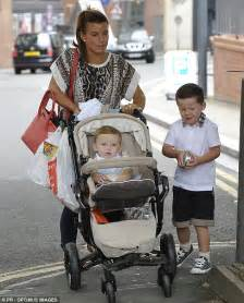klay rooney takes baby steps to the barbers with mum