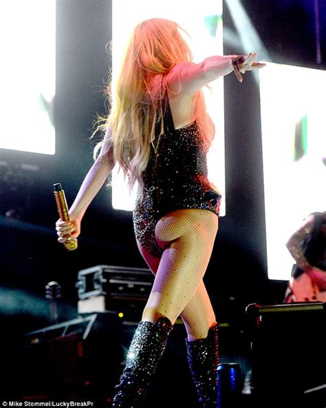 kesha hot pants kesha flashes her bra in tee and hotpants as she heads out