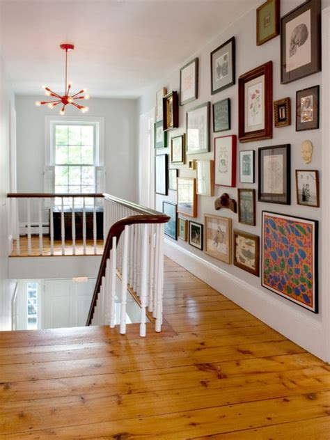 tips for hanging pictures how to hang pictures in your home s hallway
