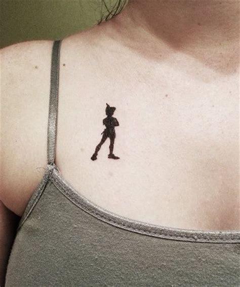 small peter pan tattoo pan black small