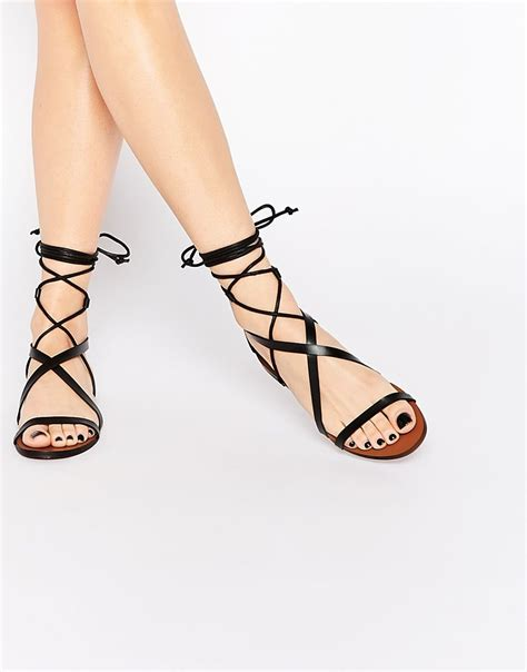 Lace Up Flat Sandals image 1 of mango strappy lace up flat sandals let s get