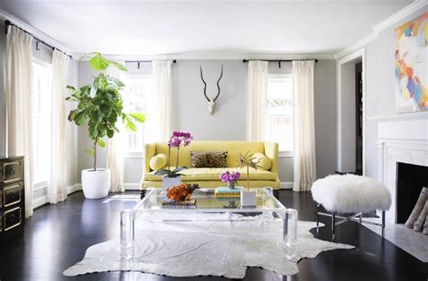 living room with yellow sofa yellow sofa contemporary living room domino magazine