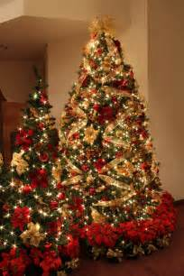 red and gold christmas tree with jeweled fruit gold