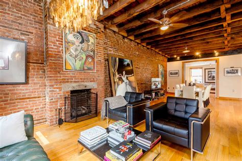 nyc room rental agencies a 32 foot living room with exposed brick dominates this hell s kitchen loft rental 6sqft