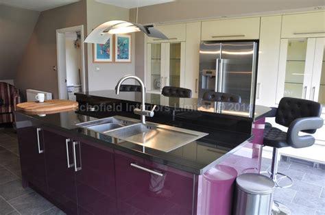 high gloss acrylic chagne aubergine kitchen