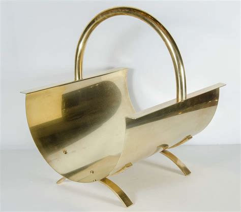 mid century modernist brass log holder in the manner of